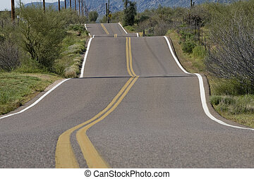 Bumpy Rural Road - Solid double yellow lines accentuate the...