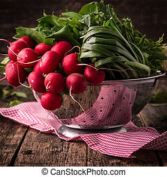 fresh vegetables in a metal colander ,healthy food on a wooden vintage table