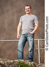 Young man full body portrait outdoors - Full length portrait...