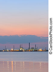 Petrochemical  refinery at sea at sunset