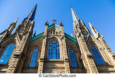 Windows and Steeples on Gothic Church - Old Stone Church in...