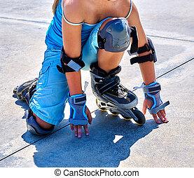 Girl riding on roller skates in skatepark. - Body part of...