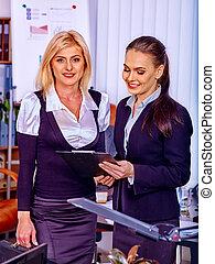 Business women working in office. - Two business women...
