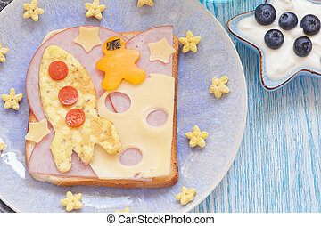 Funny sandwich with rocket and a cosmonaut on the cheese...