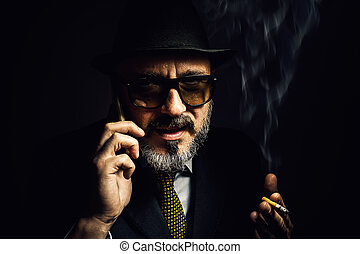 Older Man With Cellphone And Cigar - Portrait of an older...