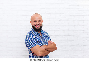 Casual Bearded Man Smiling Folded Hands Over White Brick...