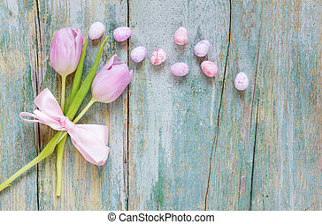 Easter decoration with tulip flowers and eggs - Two pink...