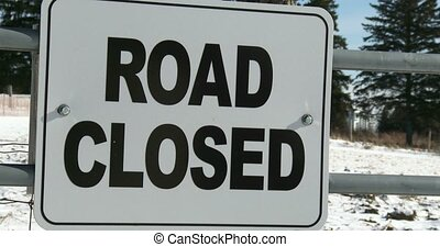 Sign indicating road closed for snow in winter in Canada