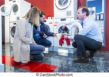White Goods Salesman - Salesman informing a couple of...