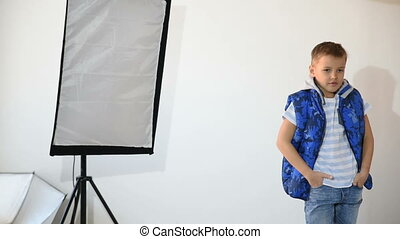 Photographer taking pictures of the child in the studio. boy...