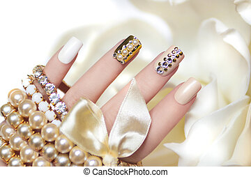 Pearl manicure. - Pearl manicure with rhinestones on a gold...