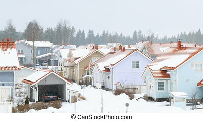 Camera moves from left to right and removes beautiful houses...
