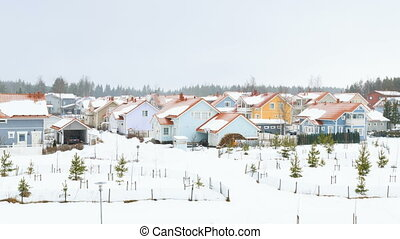 Beautiful houses during the winter period of time. Time...