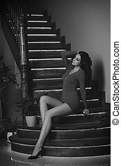 fashion woman posing on stairs in black and white
