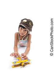 happy child girl playing with toy airplane. the dream of becoming a pilot on white.