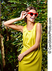 laughing girl - Pretty smiling woman in bright yellow dress...