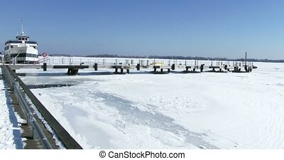 Boat docked on frozen lake Ontario