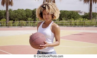 Sexy young woman posing with a basketball - Sexy young woman...