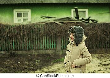 rural boy in a cap