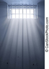 cold prison cell with sunshine through window - a cold...
