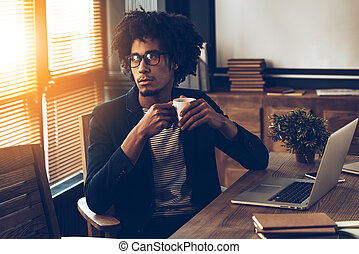 Business decision every day. Young handsome African man in...
