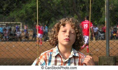 Boy On Playground Swing