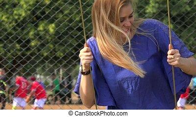 Teen Girl Swinging At Playground