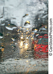 road through rain windshield - road and cars through wet...