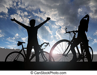 Two cyclists on a bicycle