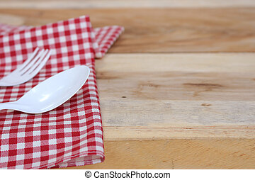 fork and spoon on tablecloth for food serving background