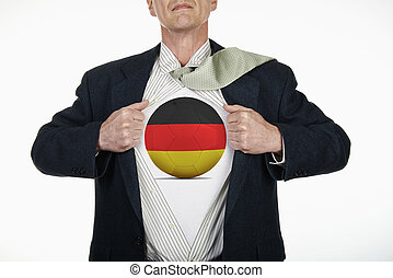 Superhero pulling Open Shirt with soccer ball - Germany