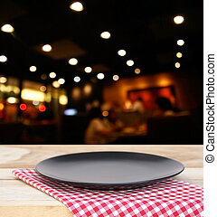 the plate on checkered tablecloth and customer at restaurant...