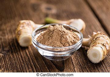 Portion of Galangal Powder(detailed close-up shot; selective...
