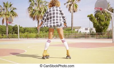 Rear view of woman on roller skates - Rear view on woman in...