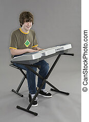 Keyboard player - Teenager playing and electric keyboard on...