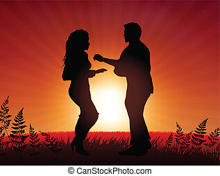 Couple dancing on sunset background
