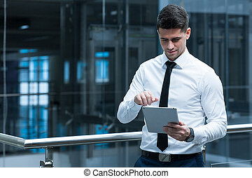 Technology helps in business - Elegant man leaning against...