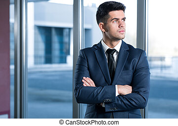 Expecting for a next big business - Handsome businessman in...