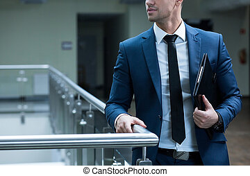Business never sleeps - Elegant man leaning against railing...
