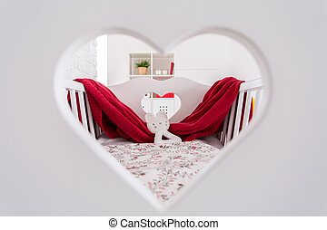 Decorated with love - Shot of a crib in a modern baby room