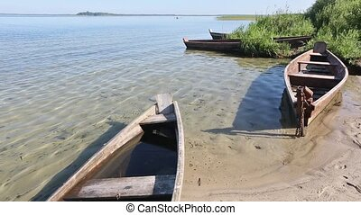 Wooden Boats on Sand near Shore - Wooden boats on sand near...