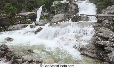 Summer Waterfall with Limpid Water. - Summer waterfall with...