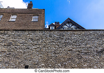 Stone walls of Tower of London historic castle on the north...