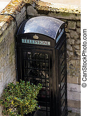 Black telephone booth in Tower of London, UK