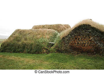 Turf houses - Traditional house made of turf and covered in...