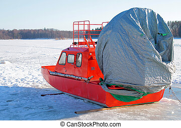 Orange boat with air screw in the winter on ice