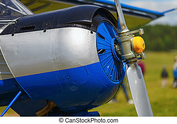 Blue airplane fuselage - Engine and propeller of blue...