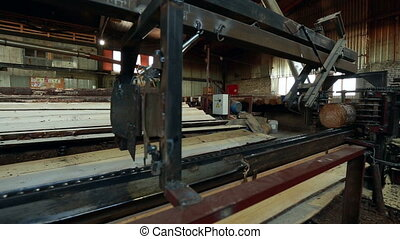 Woodworking View on running machine for sawing, close-up