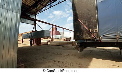Warehouse space. Truck drives for loading boards - Warehouse...
