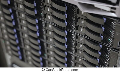 Close up of hard drives in large SAN storage - Storage array...
